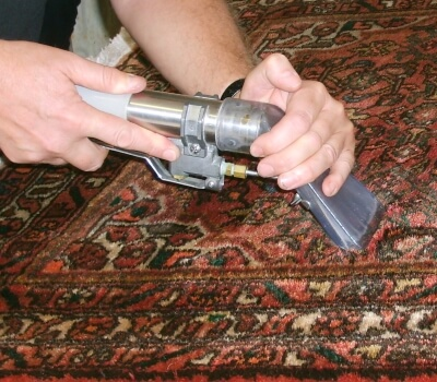 Rug being cleaned